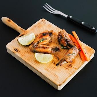 Chicken wings on cutting board