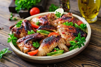 Chicken wings of barbecue in sweetly sour sauce. Picnic. Summer menu.