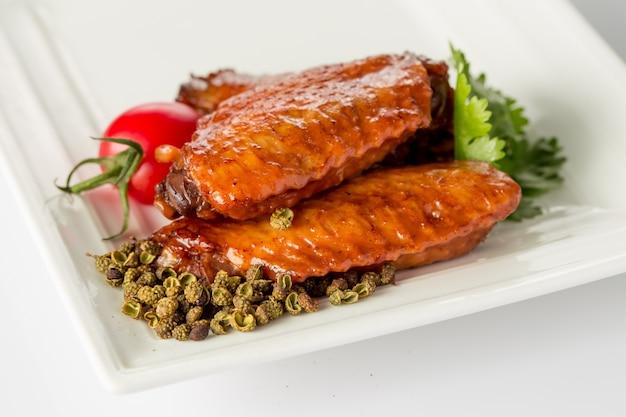 Chicken wings with garnish