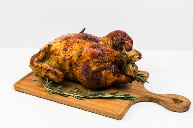 Chicken with rosemary on white