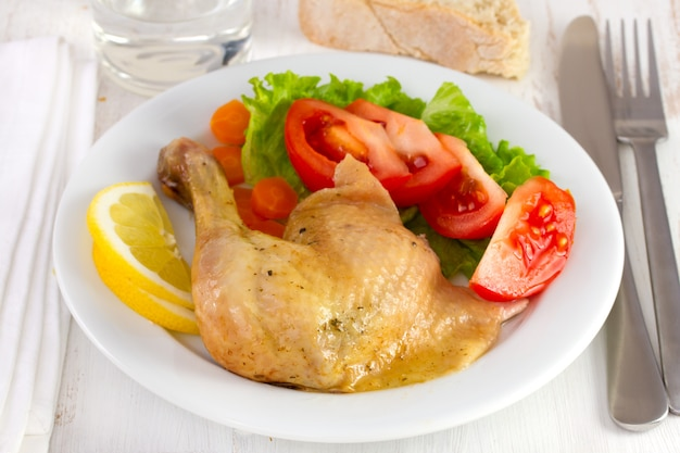 Chicken with vegetables and salad on the plate