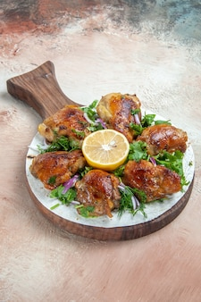 Chicken the wooden cutting board with chicken lemon herbs on lavash