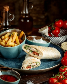 Chicken wrap and fries and tomato
