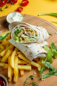 Chicken wrap served with fries