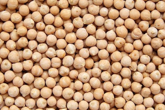Семена нута, текстура еды, фон, вид сверху. нут или фасоль гарбанзо, бобовые. белковая пища. крупным планом