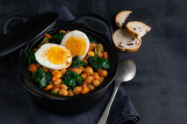 Chickpea stew spanish recipe traditional with ingredients.