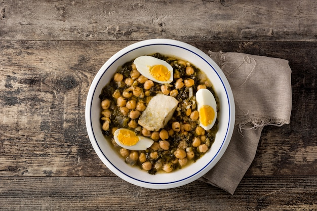 Chickpea stew with spinach and cod or potaje de vigilia top view typical spanish food for easter holidays