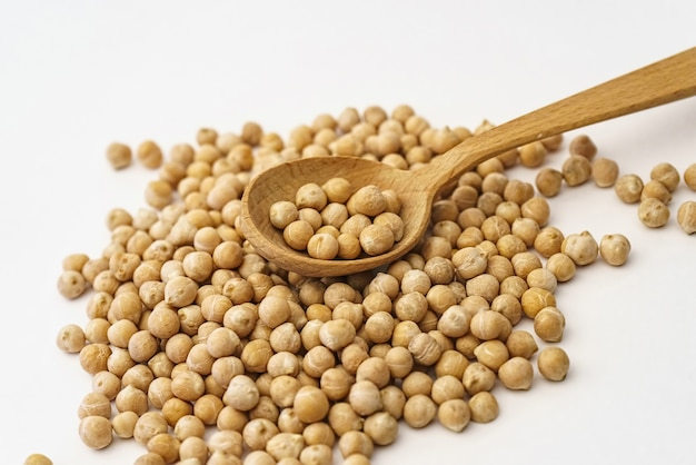 Chickpeas. a handful of chickpea isolated on a white wall.