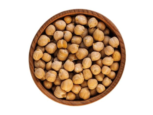 白の木製カップのひよこ豆