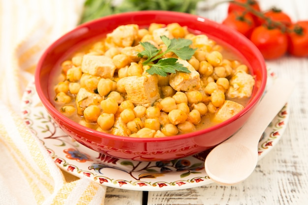 Chickpeas with turkey meat, pepper, carrots and greens.