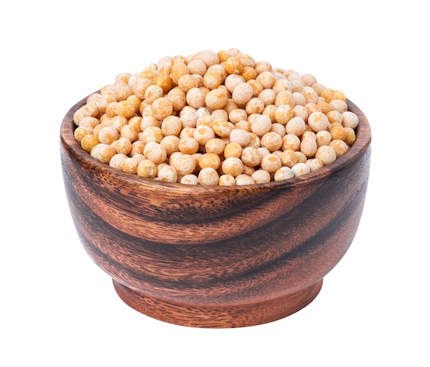 Chickpeas in wooden bowl isolated on white.