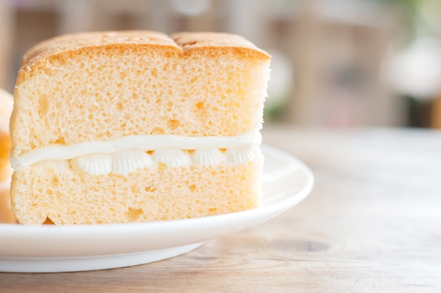 Chiffon cake with white cream in cafe