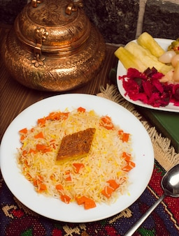 Chigirtma plov, rice garnish with vegetables and herbs.