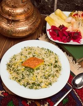 Chigirtma sebzi plov, rice garnish with vegetables and herbs
