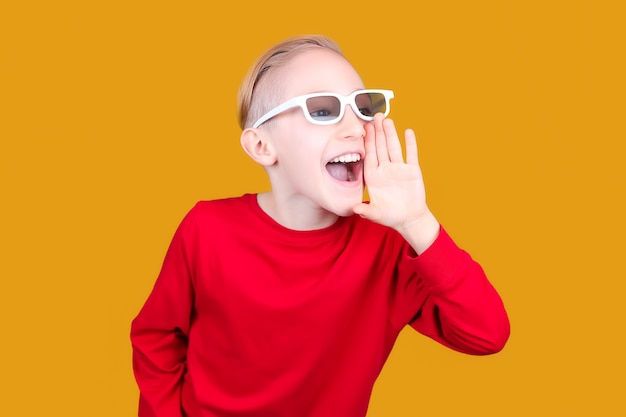 A child in 3d glasses puts his hand to his mouth and screams