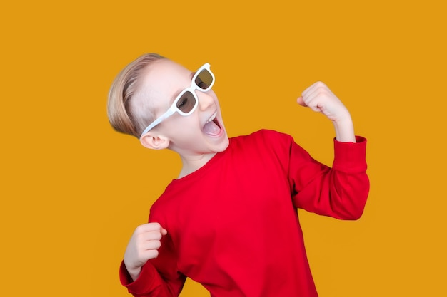 A child in 3d glasses raised his hands up as the winner