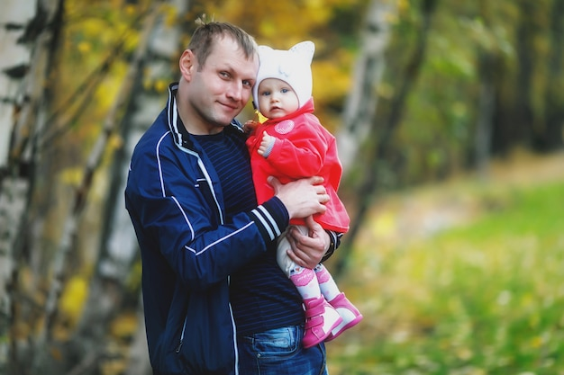 Child in arms of man's father