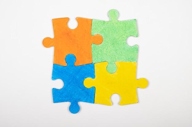 Child autism symbol colored puzzles, inclusive education.
