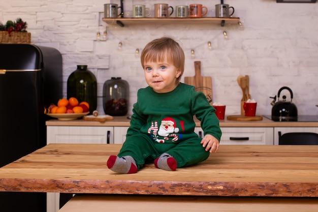Child baby boy having fun in kitchen at home
