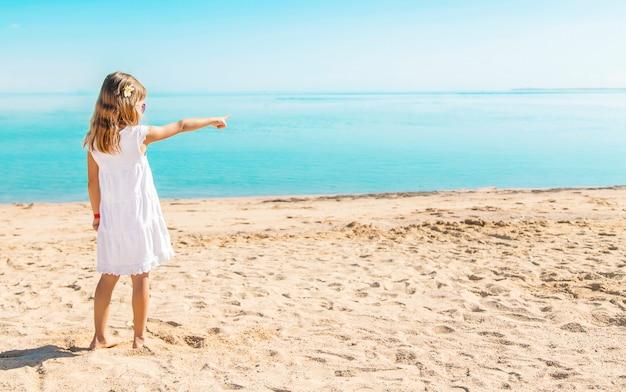 Child on the beach. sea shore. selective focus.