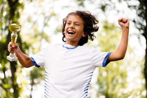 Child being victorious after a match of football