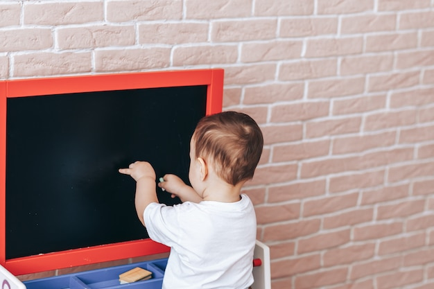 Child at the blackboard