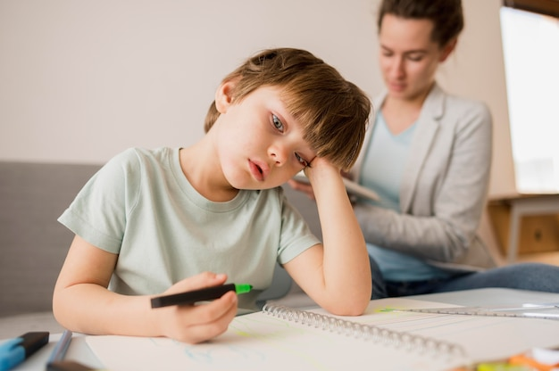 Child bored at home while being tutored