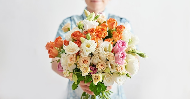 Child boy with bouquet of flowers.