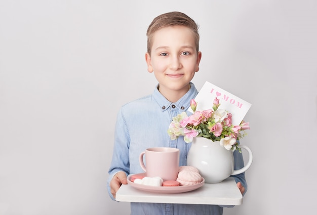 Child boy with breakfast. mother's day
