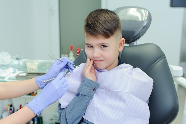 A child boy with a dentist in a dental office