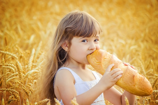 Child and bread. selective focus. food and drink.