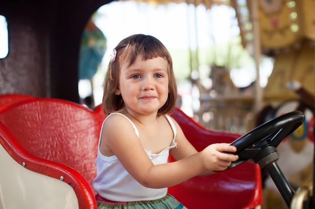 Child in carousel car