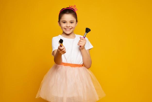 Child cheerful stylish kid in pink skirt.