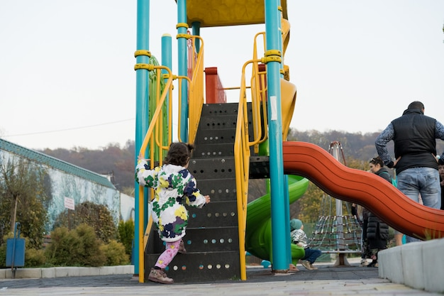 A child climbs an amusement ride