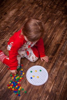 The child collects the picture from the mosaic. development of motor skills