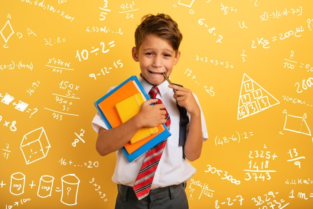 Child cries because he has a lot of school homework emotional expression