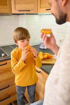 Child and dad eating an orange