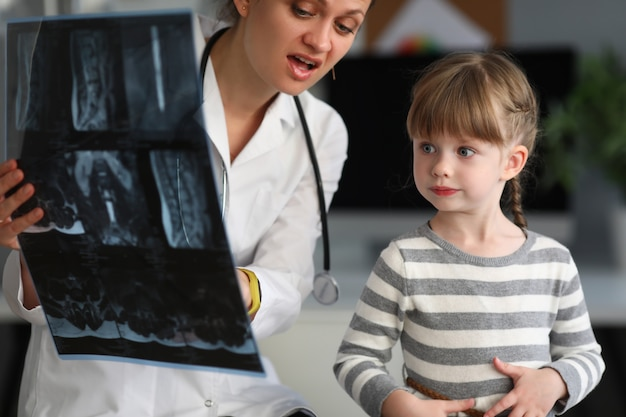 Child doctor specialist look x-ray image in hospital