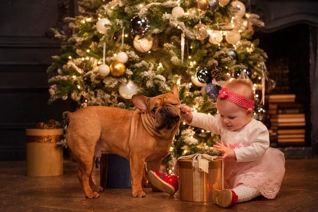Child, dog and christmas tree