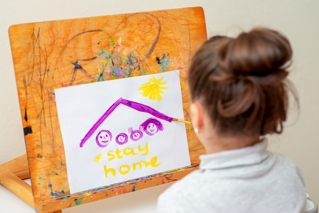 Child draws family under roof