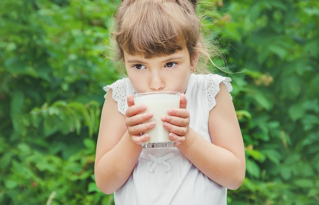 The child drinks milk and cookies. selective focus.