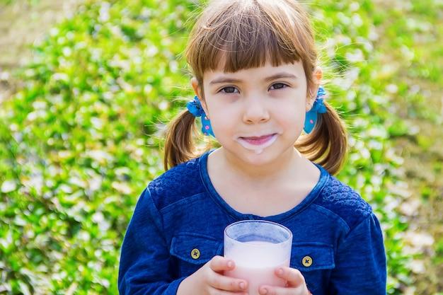 The child drinks milk. selective focus. kids.