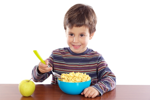 Child eating breakfast over white background