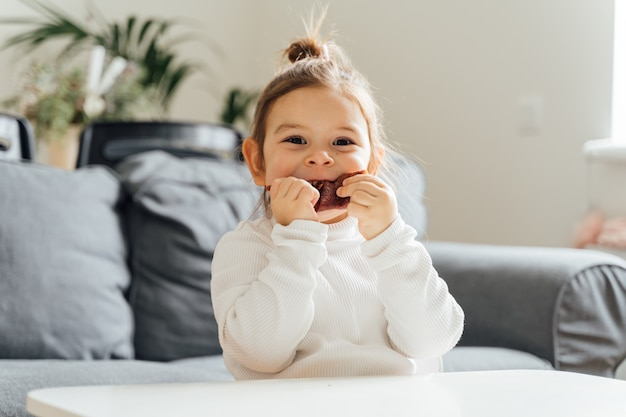 Child eating dried fruit leather for snack at home. zero sugar natural sweets for kids. vegetarian diet. natural toddler snack. high quality photo