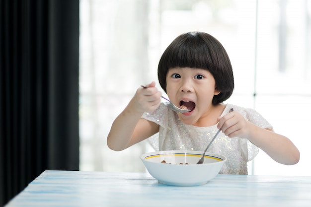 Child eating food, happy time, breakfast