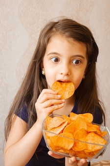 Child eats chips. selective focusfood