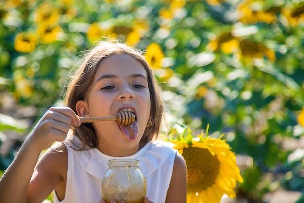 The child eats flower honey. selective focus. nature.