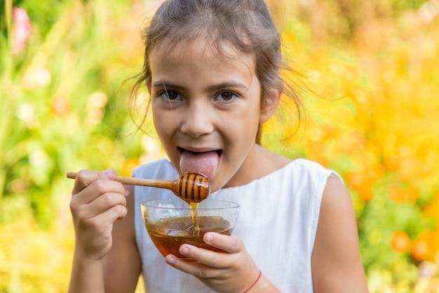 The child eats flower honey. selective focus.