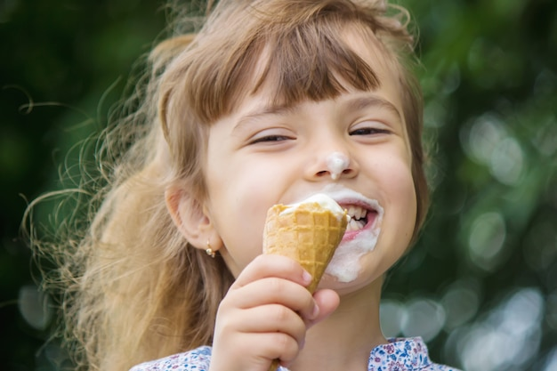 The child eats ice cream. selective focus.