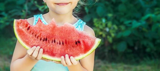 A child eats watermelon. selective focus. food.